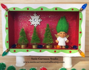 Troll Angel Holiday - small wood diorama. Green haired troll doll angel, mini Christmas trees, Christmas lights, snowflake.