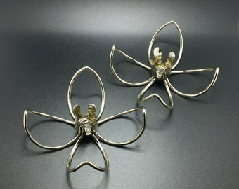Two vintage candle holders, silver colored