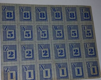 WWII era 24 ration stamps full sheet blue image numbers letters page Vintage military paper ephemera art supplies