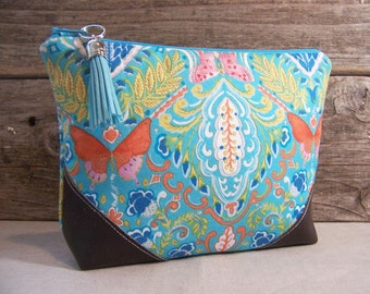 Cosmetic bag - Make up bag clutch in beautiful aqua fabric with butterfly and  faux  leather corners and a vinyl lining ,  make up bag.