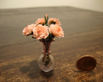 Miniature  glass vase  with  pink  roses
