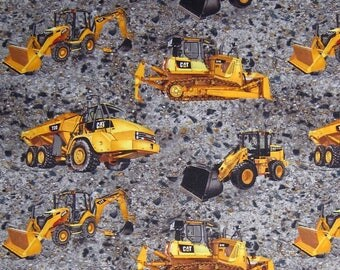 Cat machines on gravel