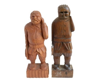 Carved wooden figures, folk art men, holding hats, hand over ear, sculpture, figural wood carving, from Elizabeth Rosen