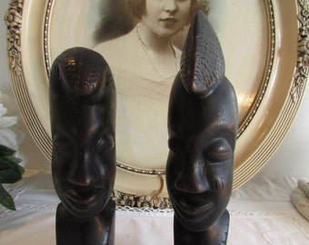 Pair of African wooden sculptures, heads, statues.