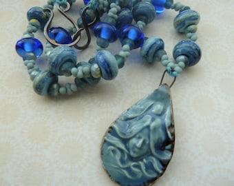 handmade copper, blue lampwork glass and ceramic necklace, UK jewellery