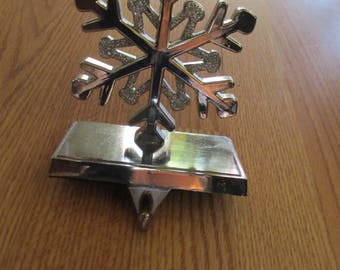 Stocking Holder Snowflake Silver tone finish weighted metal base used