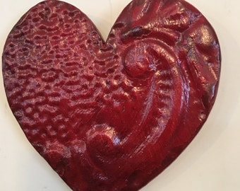 Ornate red heart designed with antique tin ceiling tile
