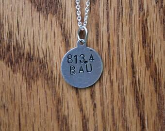 813.4 BAU - L. Frank Baum Dewey Decimel Metal Stamped necklace