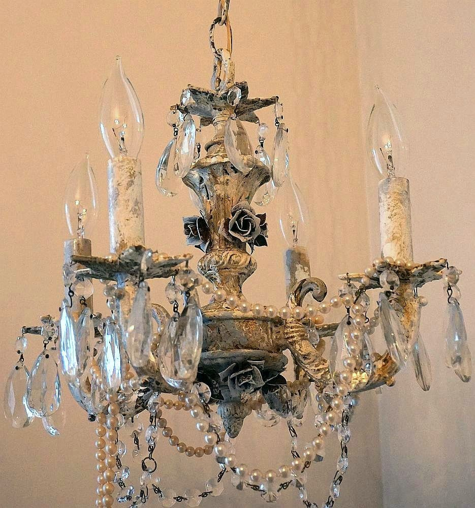Distressed crystal chandelier lighting heavily weathered rusty