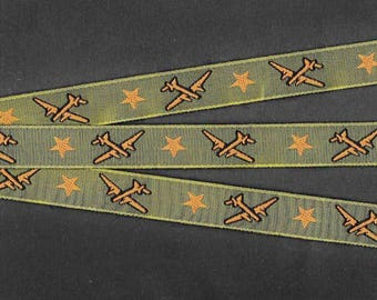 "Jacquard Ribbon Trim, Poly, 5/8"" Wide, NOVELTY, Olive Green Background with Carmel Brown Airplanes and Stars, Black Accents, Priced Per Yard"