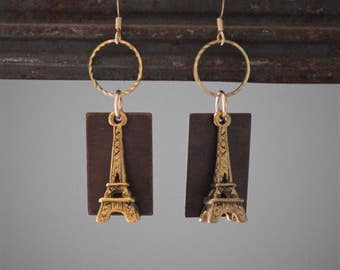 Suzette Earrings: Golden brass Eiffel towers dangle with antique brass and golden rings on 14k gold filled ear wires