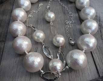 Bulky and light weight necklace set. Sterling silver and hand made cotton pearls.