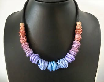Pastel rainbow gradient wire beads necklace/ each bead a different color/ polymer clay increasing size beads on rubber base chain.