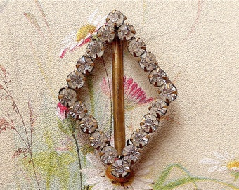 Shoe buckle, Bohemian, vintage.  It is diamond shaped with claw set diamante,  c1910.