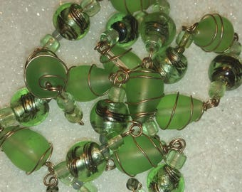 27  Large Frosted Green Beads most wrapped in Wire. Beautiful.