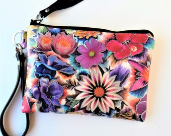 Moonlight floral leather wristlet.  Leather wristlet in colorful midnight floral.