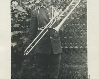 Woman in military uniform w trombone antique photo