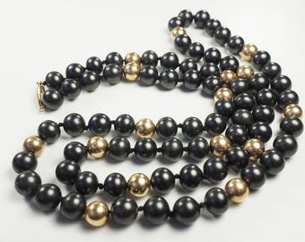 Long modern 14k gold and black faux pearl bead necklace