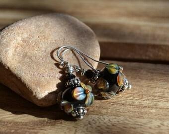 Bali silver and floral lampwork dangle earrings.