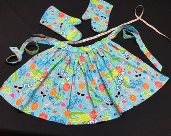 Florida-inspired apron and oven mitts
