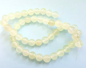 15 Inch Strand of Pale Yellow Natural Jade Gemstone Beads!!  9mm in Size.  48 Gorgeous Beads.  Feminine and Unique!!  Great Beads!!