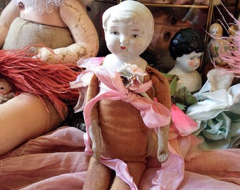 Vintage bisque doll stuffed cloth body antique Japan porcelain head flapper girl doll