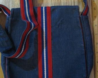 1970s denim shoulder bag; red suede lining; red, white, blue trim. Vintage Retro 70's tote bag; no pockets. 28 inch cloth handles; Bag 9 X 8