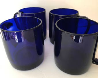 Beautiful set of four  cobalt blue glass coffee mugs- Nice Condition