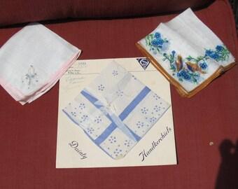Small silk hankies x 2; one unused hanky on original cardboard presentation; THREE handkerhiefs; 1940's