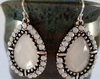 Silver and white dangle earrings