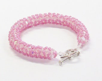 Handmade Beaded Bead Woven Bracelet in Pink Over Clear Crystals 7""