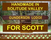 National Park name and lodge sign, GUNDERSON LODGE old school look and feel, cut on thick old barn beam stained traditional brown and yellow