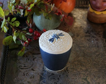 pot and covered in ceramic blue and white color, handmade