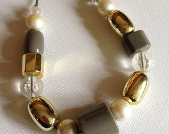 beaded necklace interesting collection of chunky plastic cream grey and gold beads