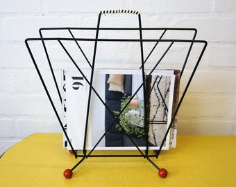 Vintage atomic magazine rack