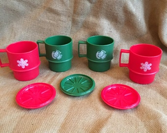 4 Christmas tupperware mugs, and 3 coasters
