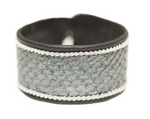 No. 1102: Sami Bracelet with salmon leather, pewter thread and reindeer leather.