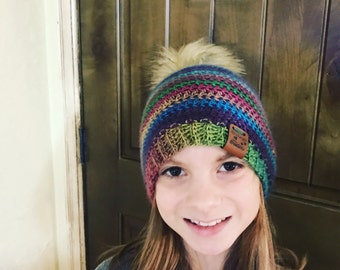 Fur pom pom crochet  beanie made with red heart unforgettable yarn stained glass