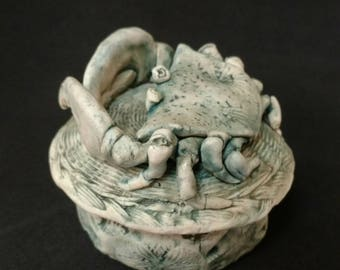 porcelain box with crab on the top.