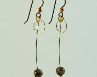 Silver and fossil hypoallergenic earrings.
