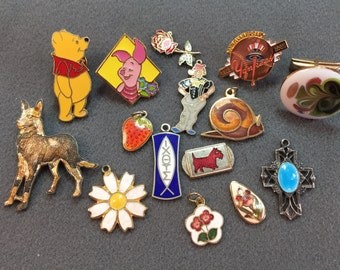 Fifteen Small Vintage Enamel Pieces-Dogs, Disney, and the New York Yankees.  Free shipping