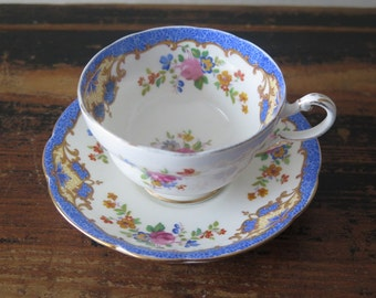 Paragon Fine China Cup & Saucer Made in England Marked reproduction of period Plymouth, Blue Pink Gold Roses Floral Porcelain @223