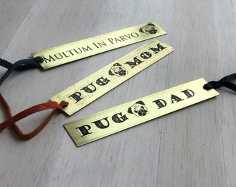 Pug theme bookmarks. Etched brass & leather. Mom, dad or pug motto 'Multum in parvo'. 25% of sale to pug charity. Gift bag included.