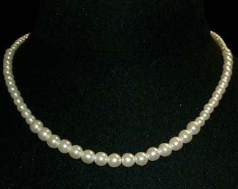"""Style # 9590-16 - Graduated Simulated Ivory Pearl Necklace - 16"""""""