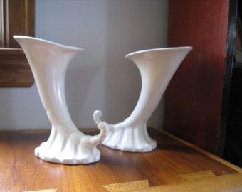 pair of Roseville Pottery cornucopia vases. Cream colored, collectible art pottery. Mid Century decor.