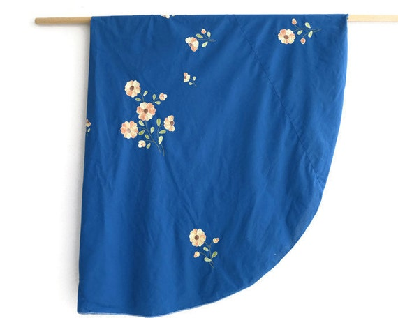 Large oval blue tablecloth with 8 napkins, appliqued and embroidered flowers with yellow and orange petals, mid 20th century