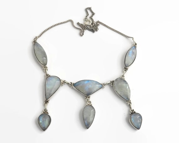Rainbow moonstone necklace in sterling silver setting, 8 large blue cabochon cut stones in bezel settings, fine curb link chain, 44 grams