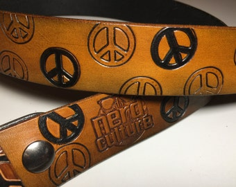 Brown Antiqued Single-ply Belt with Natural and Black Peace Signs and Silver Colored Roller Peace Sign Buckle
