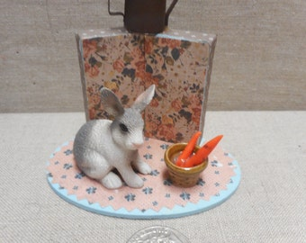 Miniature scene - rabbit with carrots and watering can