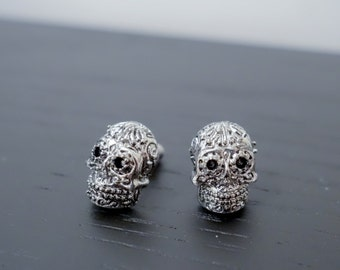 Quirky mustached 3D silver tone skull earrings stud
